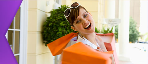 Lady smiling holding shopping bags